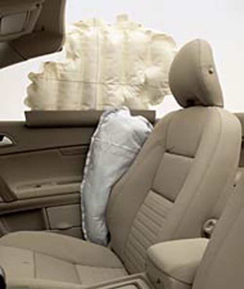Door- and seat-mounted airbag